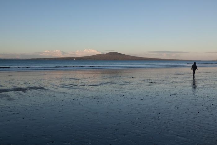 Running On Takapuna Beach In Auckland New Zealand